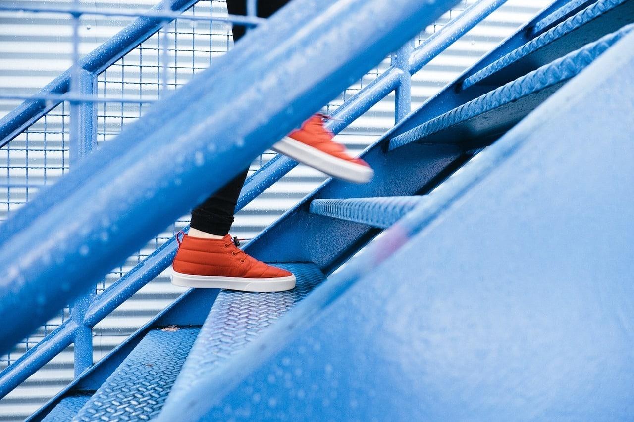 closeup of feet running up stairs