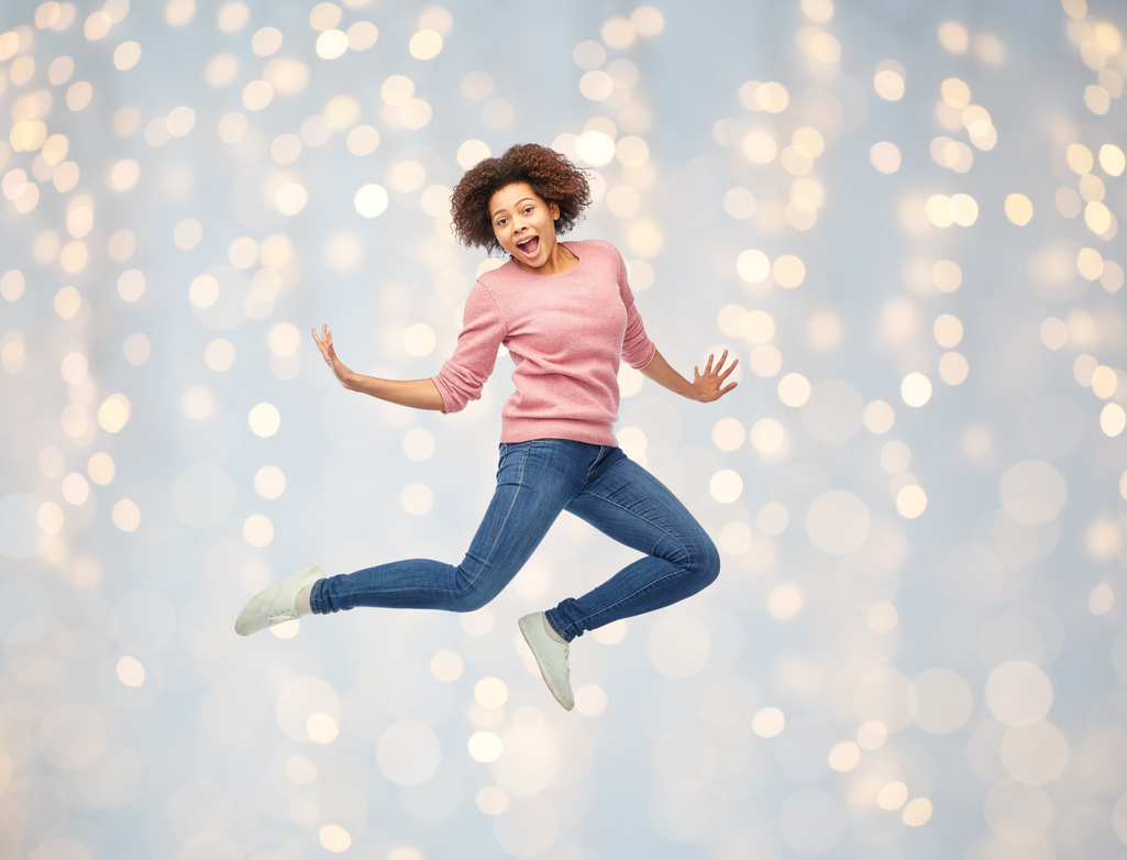 woman jumping in the air posing